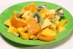 Fresh fruit salad on a green plate Royalty Free Stock Photo