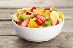 Fresh fruit salad on grey wooden background. Fresh fruit salad on grey wooden background Stock Photography