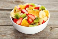 Fresh fruit salad on grey wooden background. Fresh fruit salad on grey wooden background Royalty Free Stock Images