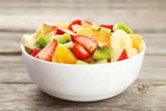 Fresh fruit salad on the grey wooden background. Fresh fruit salad on grey wooden background Stock Image