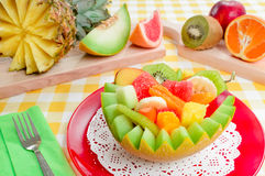 Fresh fruit salad in handmade melon bowl. Royalty Free Stock Image