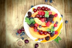 Fresh fruit salad made with organic fruits in plate. Fresh fruit salad made with organic fruits - healthy food, vegetarian eating, healthy eating Stock Photography