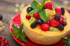 Fresh fruit salad in the melon stock image