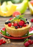 Fresh fruit salad in the melon Royalty Free Stock Image