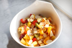 Fresh fruit salad with nuts as healthy breakfast. Royalty Free Stock Photography