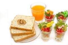 Fresh fruit salad with orange juice, fusion food Royalty Free Stock Photos