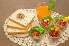 Fresh fruit salad with orange juice, fusion food Stock Photos