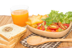 Fresh fruit salad with orange juice and slice bread Royalty Free Stock Photography
