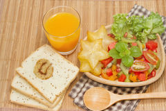 Fresh fruit salad with orange juice and slice bread fusion food Royalty Free Stock Images