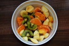 Fresh fruit salad with orange, kiwi, apple and banana stock images