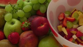 Fresh fruit salad on a plate stock video footage