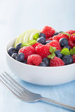 Fresh fruit salad with raspberry blueberry apple Stock Photos