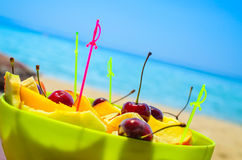 Fresh fruit salad and sea in the background Royalty Free Stock Image