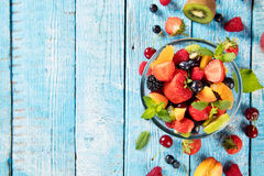 Fresh fruit salad served on wooden table Royalty Free Stock Image
