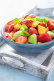 Fresh fruit salad with strawberry, apple, nectarine, pomegranate Stock Image