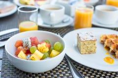 Fresh fruit salad, waffles, cake, coffee and juice Royalty Free Stock Images