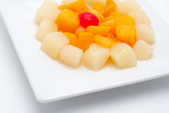 Fresh fruit salad on the white plate Royalty Free Stock Photos