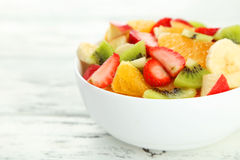 Fresh fruit salad on a white wooden background Royalty Free Stock Photo