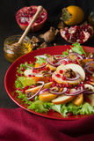 Fresh fruit salat with perssimons and garnet Royalty Free Stock Photography