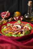 Fresh fruit salat with perssimons and garnet Royalty Free Stock Photo
