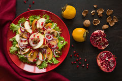 Fresh fruit salat with perssimons and garnet Stock Images
