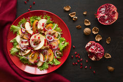 Fresh fruit salat with perssimons and garnet Royalty Free Stock Image
