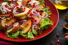 Fresh fruit salat with perssimons and garnet Royalty Free Stock Photos
