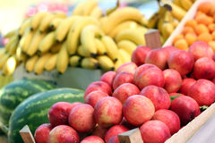 Fresh Fruit For Sale. Fresh, ripe nectarines, bananas, watermelons and other fruit on the fruit stand for sale Stock Photography