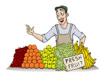 Fresh fruit. Seller, smiling presenting his produce Royalty Free Stock Image