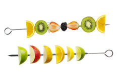 Fresh fruit on a skewer. Fresh fruit selection on white background Stock Image