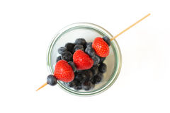 Fresh fruit skewer strawberry and blueberry - isolated Royalty Free Stock Images