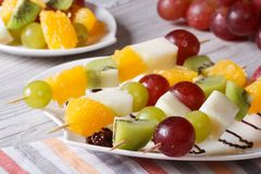 Fresh fruit on skewers close-up. Horizontal Stock Photography