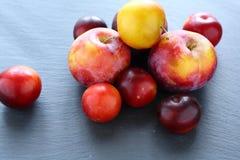 Fresh fruit on slate background Royalty Free Stock Image