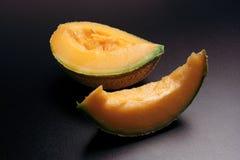 Fresh fruit: slice of melon stock photography