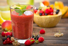 Fresh fruit smoothie in the glass. On the wooden table Royalty Free Stock Photo