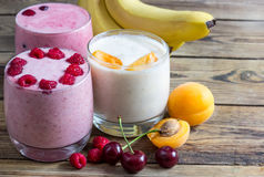 Fresh Fruit Smoothies. Assorted fruit smoothies on a rustic table. Place for text. Selective focus Stock Photo