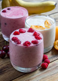 Fresh Fruit Smoothies. Assorted fruit smoothies on a rustic table.  Selective focus Royalty Free Stock Photography
