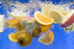 Fresh fruit splashing in fresh water Royalty Free Stock Photography