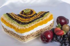 Fresh fruit on a sponge cake Royalty Free Stock Image