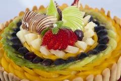 Fresh fruit on a sponge cake Stock Photos