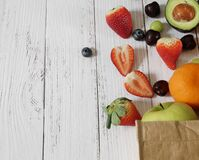 Free Fresh Fruit Spread From Paper Craft On Wooden Table Stock Images - 191025694