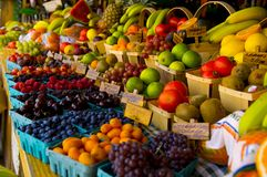 Fresh Fruit Stand. With boysenberries, raspberries, cherries and grapes stock photo