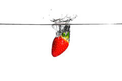 Fresh Fruit. Strawberry falling into clear water Stock Photo