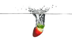 Fresh Fruit. Strawberry falling into clear water Stock Images