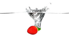 Fresh Fruit. Strawberry falling into clear water Stock Photography
