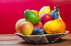 Fresh fruit on a table in basket royalty free stock photos