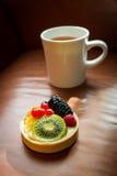 Fresh fruit tart on leather background Stock Images