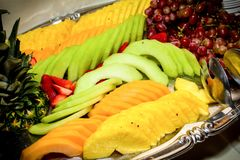 Fresh Fruit Tray. A Fresh fruit tray featuring pineapple, strawberries grapes and cantaloupe Stock Photography