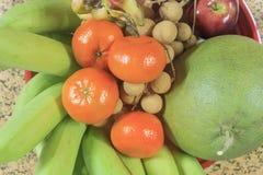 Fresh fruit on tray. Orange, banana, grapefruit, apple and longan Royalty Free Stock Image