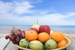 Fresh fruit and tropical beach Stock Photos
